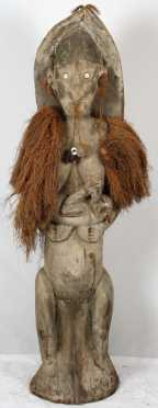 Tall Carved Female Ancestral Figure, New Guinea