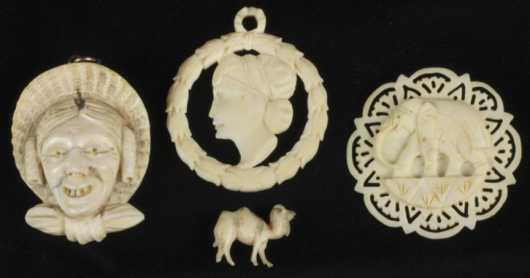Three Ivory Carved Pendants and a Miniature