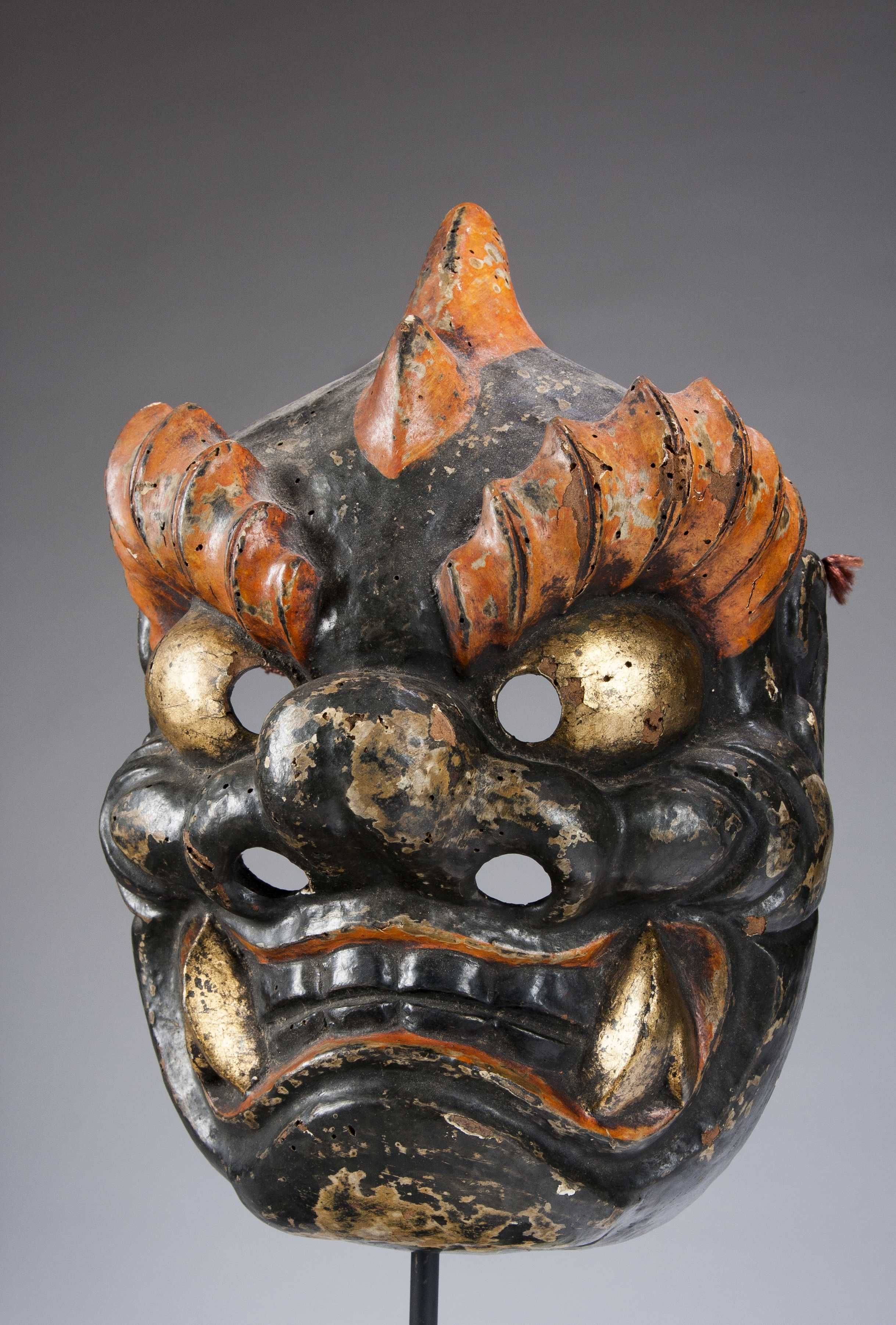 a japanese demon or monster mask from the 20th century