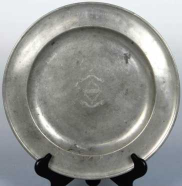 "Pewter Charger, deep dish with central engraved family crest, marked on rim ""MH"""