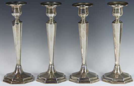 Four Weighted Sterling Silver Candlesticks