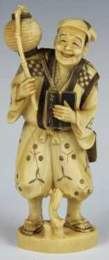 Carved Ivory Smiling Figure of a man