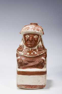 A Moche vessel in the form of a seated nobleman, 300 - 600 AD