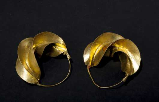 A pair of Senegalese gold earrings