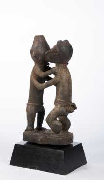 A Baule shrine carving of fighting monkeys