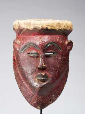 A fine and rare Red Punu or Lumbo mask