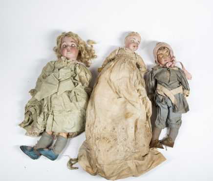 Four Bisque Head Dolls