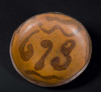 693 Slip decorated Redware Dish