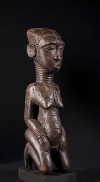 A fine Kuba kneeling divination figure