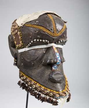 A Kuba Bwoom helmet mask