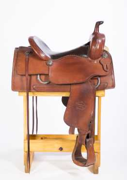 Western Saddle-McLelland, a two tone leather saddle with barbed wore tooling