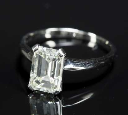 Emerald Cut Diamond, set as a ring, unmarked probably platinum, 2.6 carats