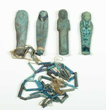 Four Egyptian Blue Faience Ornaments