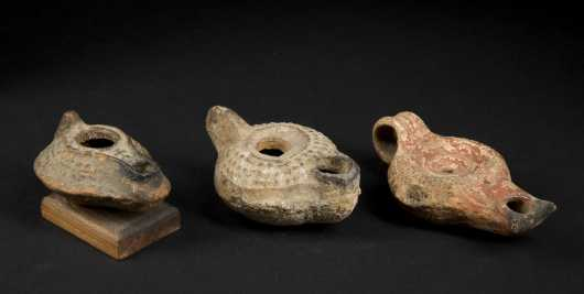 Three Ancient Roman/Mediterranean terracotta oil lamps