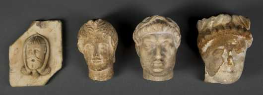 Four Roman Period Stone Heads