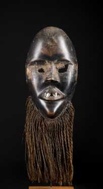 A fine and rare Dan mask--Ex. Kamer