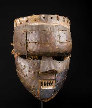 A fine and old copper clad Salampasu face mask--Ex. Kamer
