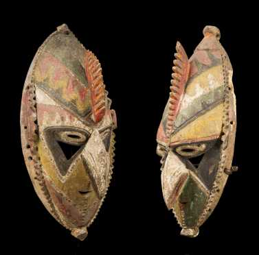 A Superb and rare pair of Lower Sepik masks