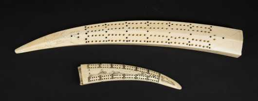 Two Inuit cribbage boards