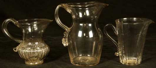 Three Hand-blown Clear Pitchers