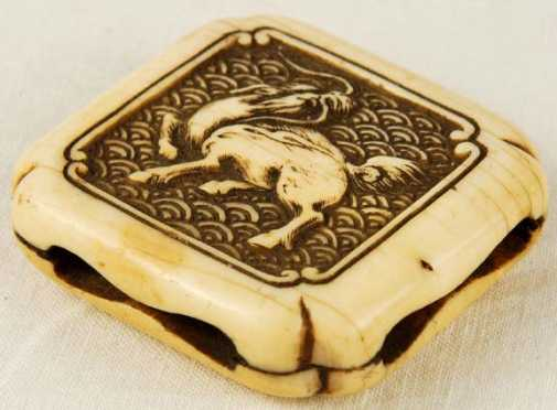 An Ivory Square Shaped Manju Netsuke, signed