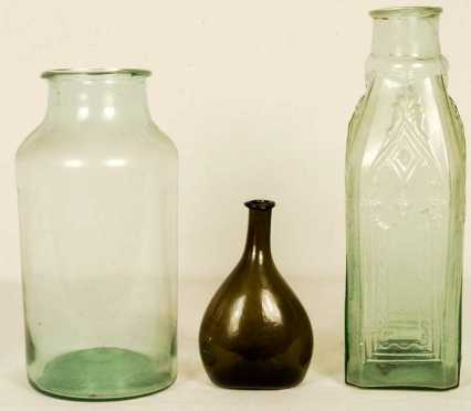 Two Green Glass Storage Jars And A Bottle