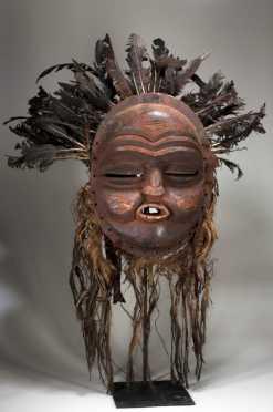 A fine and intact Mbunda sachihongo mask.  Zambia