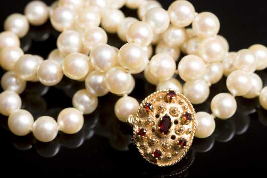 Strand of Pearls with 14Kt. Gold and Garnet Clasp