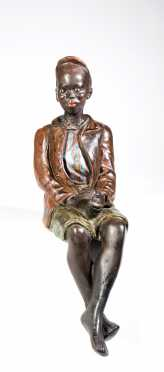 Painted Chalk Seated Black Boy Figure