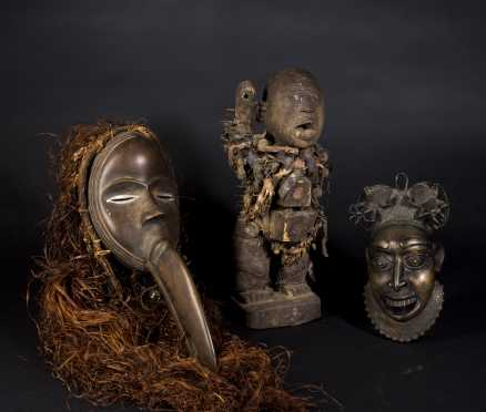 A Group of Decorative African Masks and Objects
