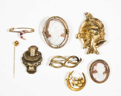 Lot of Eight Yellow Gold Brooches and Pins