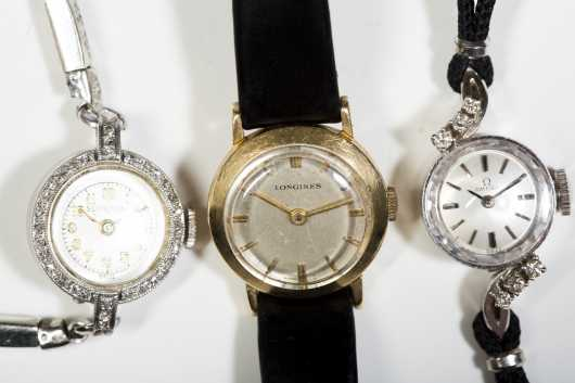 Three Gold and Platinum Ladies Dress Watches with Diamonds