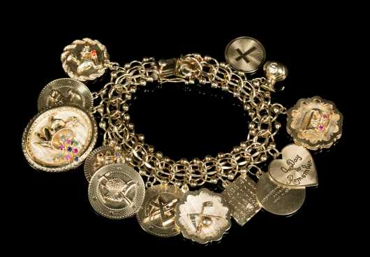 Yellow Gold 14kt. Charm Bracelet with Thirteen Charms