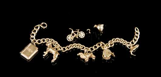 Yellow Gold 14kt. Charm Bracelet with Seven Charms