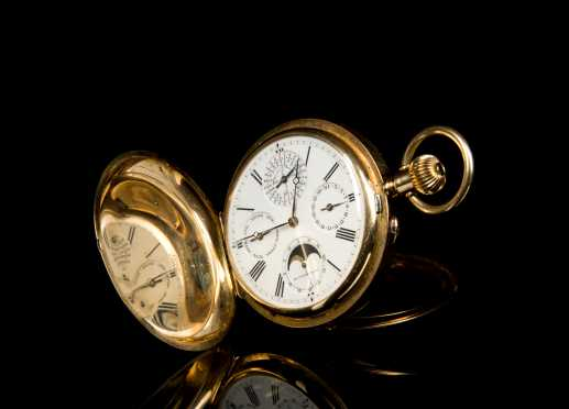 Henry Moser & Cie., Heavy multicolor gold perpetual calendar hunting cased pocket watch for Imperial Russian Market