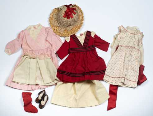 Nine Pieces of Doll's Clothing in Reds and Pinks