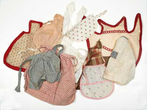 Ten Antique Cotton Plaid and Red Print Doll Aprons
