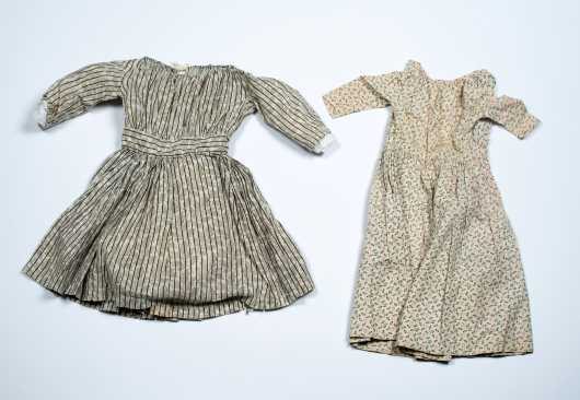 Two Early Hand Sewn Doll Dresses