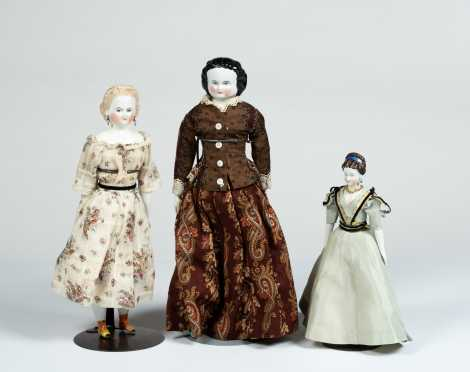 Lot of Three Dolls Two China Dolls and One Untinted Bisque