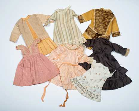 Lot of Seven Doll's Dresses