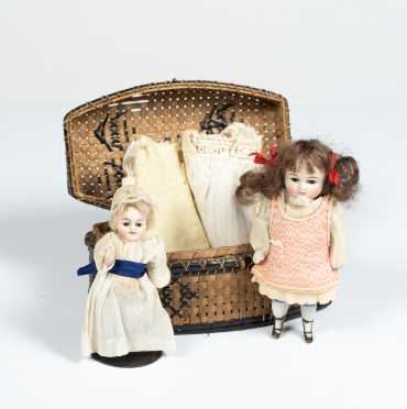 Lot of Two All Bisque Dolls in Basket and Extra Clothing