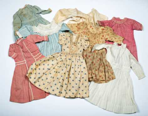 Lot of Eight Doll's Dresses