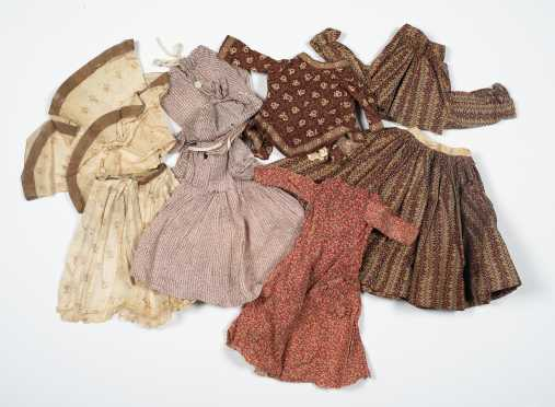 Nine Pieces of Early Doll Clothing