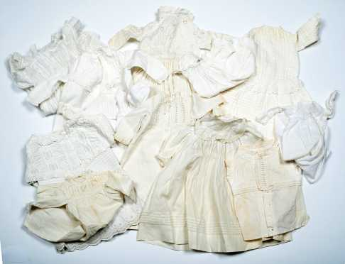 Twelve Pieces of White Doll's Clothing