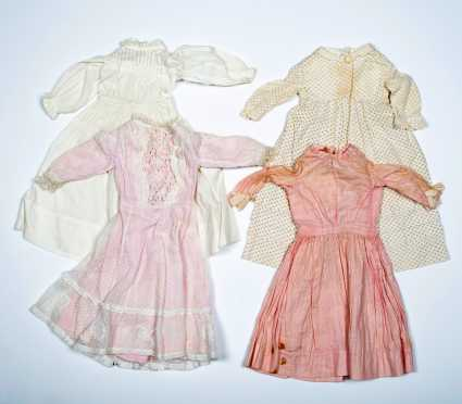 Four Doll's Dresses