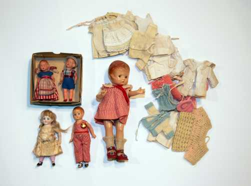 Lot of Five Dolls and Clothes