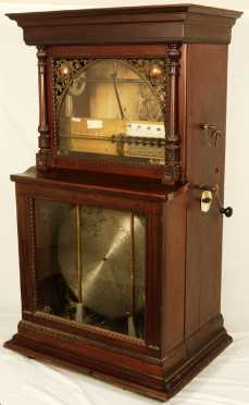 Regina Sublima Corona, Automatic Disk Changer Music Box. Floor Model.