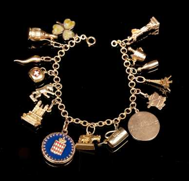Yellow Gold Charm Bracelet with Fifteen Charms