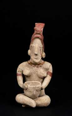 A Delicate Pre Columbian Seated Figure Holding a Bowl