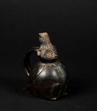 A Pre Columbian Chimu Zoomorphic Handled Vessel, Peru